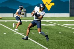 Wide Receiver Sam Brown makes a catch during a WVU Football practice on March 27, 2021 in Milan Puskar Stadium. (Duncan Slade/WVSportsNow)