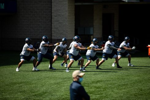 A group of offensive linemen during a WVU Football practice on March 27, 2021 in Milan Puskar Stadium. (Duncan Slade/WVSportsNow)