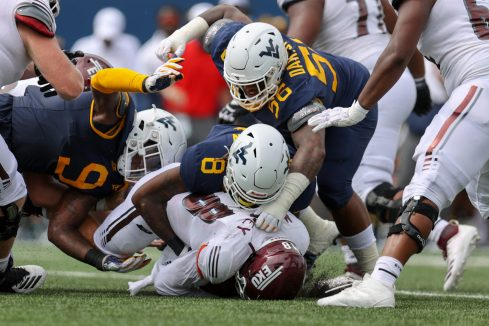 MORGANTOWN, WV - SEPTEMBER 12: West Virginia Mountaineers linebacker VanDarius Cowan (8) sacks Eastern Kentucky Colonels quarterback Parker McKinney (18) during the first quarter of the college football game between the Eastern Kentucky Colonels and the West Virginia Mountaineers on September 12, 2020, at Mountaineer Field at Milan Puskar Stadium in Morgantown, WV. (Photo by Frank Jansky/Icon Sportswire)