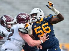West Virginia Mountaineers defensive lineman Darius Stills (56) works around Eastern Kentucky Colonels offensive lineman Tucker Schroeder (52) during an NCAA football game on Saturday, September. 12, 2020, in Morgantown, West Virginia.