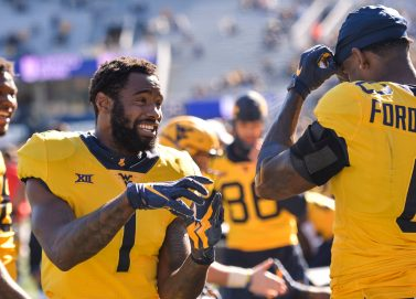 West Virginia Mountaineers wide receiver T.J. Simmons (1) talks with wide receiver Bryce Ford-Wheaton (0)Saturday, Oct. 31, 2020, in Morgantown, WV.