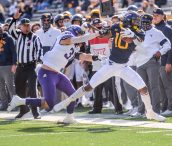 West Virginia Mountaineers wide receiver Sean Ryan (10) is pushed out of bounds by TCU Horned Frogs linebacker Garret Wallow (30) on Saturday, Nov. 14, 2020, in Morgantown, W.Va.