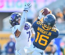 West Virginia Mountaineers wide receiver Winston Wright Jr. (16) makes a catch over TCU Horned Frogs safety Trevon Moehrig (7) on Saturday, Nov. 14, 2020, in Morgantown, W.Va.