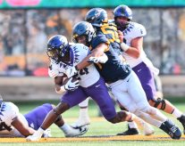 TCU Horned Frogs running back Darwin Barlow (24) is tackled by West Virginia Mountaineers linebacker Tony Fields II (1) on Saturday, Nov. 14, 2020, in Morgantown, W.Va.