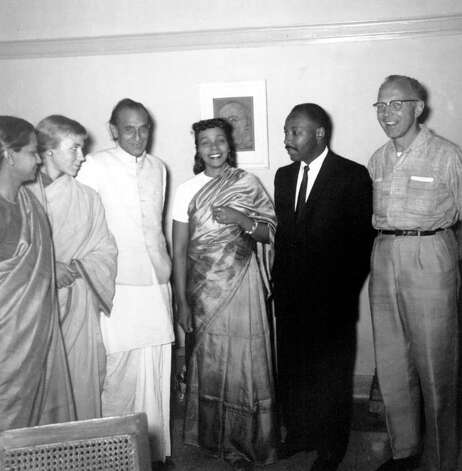 Pastor of Montgomery, Al., Dr. Martin Luther King Jr., and his wife, Coretta King, center wearing sari, pose in the home of Acharya J.B. Kripalani in New Delhi, India on March 10, 1959.  The Kings are touring India visiting with Gandhi's followers and leaders.  From left to right are, Ms. Shanti, personal secretary to Kripalani; Barbara Bristol; Kripalani, considered the best among the interpreters of Gandhi's teachings; Mrs. King; Dr. King; and James E. Bristol, secretary of the local Quaker center, which is sponsoring the Kings' trip.  (AP Photo) / Beaumont