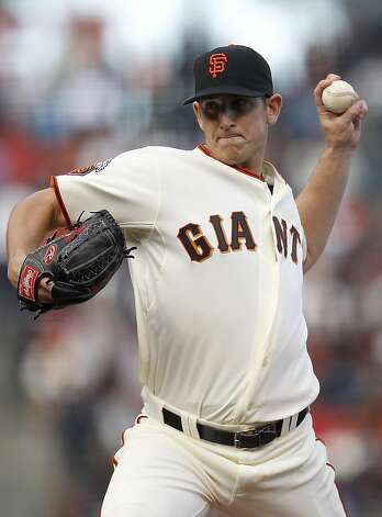 San Francisco Giants starting pitcher Eric  Surkamp throws to the Houston Astros during the first inning of a baseball game in San Francisco, Saturday, Aug. 27, 2011. (AP Photo/Tony Avelar) Photo: Tony Avelar, AP