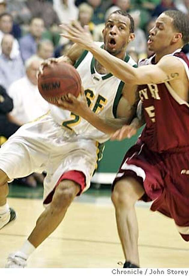 Andre Hazel (2) of USF drives against Rodney Billups of Denver. The USF Dons vs. the University of Denver Pioneers in the NIT basketball tournament at USF. John Storey San Francisco Event on 3/16/05 Photo: John Storey