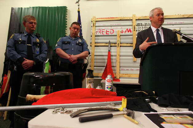 Seattle Mayor Mike McGinn speaks during a press conference showing some of the items confiscated during a May Day rally the previous day. The press conference was on Wednesday, May 2, 2012 at the Seattle Police Department's West Precinct. Photo: JOSHUA TRUJILLO / SEATTLEPI.COM