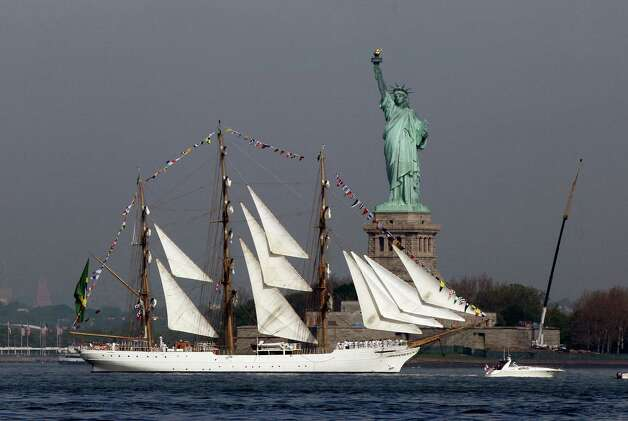 The Cisne Branco, from Brazil, sails by the Statue Of Liberty, in New York, to participate in Fleet Week activities, Wednesday. This year's event marks the bicentennial of the War of 1812. (AP Photo/Richard Drew) Photo: Associated Press / SL