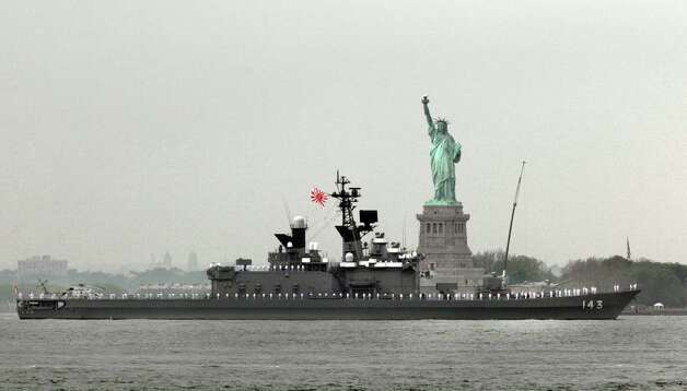 The JS Shirane, from Japan, sails by the Statue Of Liberty, in New York, to participate in Fleet Week activities, Wednesday. (AP Photo/Richard Drew) Photo: Associated Press / SL