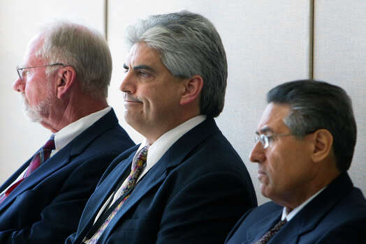 Paul Becker, left, who resigned as director of the Harris County Probation Department, was questioned this week, along with deputy directors Ray Garcia, center, and Gilbert Garcia, about mishandling of drug tests at the agency. The investigation was launched by defense attorney Lisa Andrews. Photo: Cody Duty / © 2011 Houston Chronicle