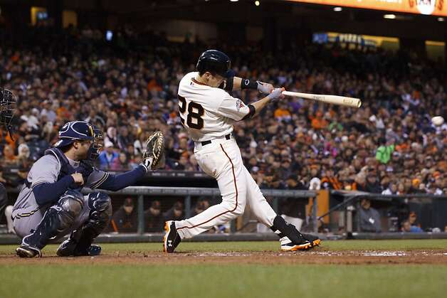 SAN FRANCISCO, CA - AUGUST 05: Buster Posey #28 of the San Francisco Giants hits a single against the Milwaukee Brewers during the third inning at AT&T Park on August 5, 2013 in San Francisco, California. (Photo by Jason O. Watson/Getty Images) Photo: Jason O. Watson, Getty Images
