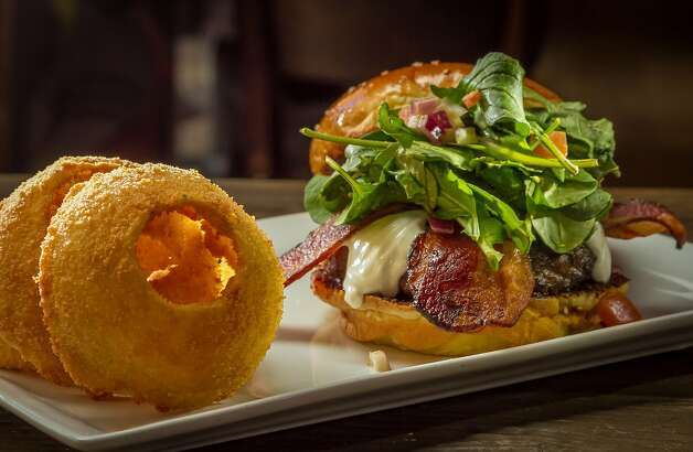 The Fresno Fig burger - here with onion rings - is a favorite at Berkeley's Eureka, which has transformed a mundane space into a dramatic dining room. Photo: John Storey