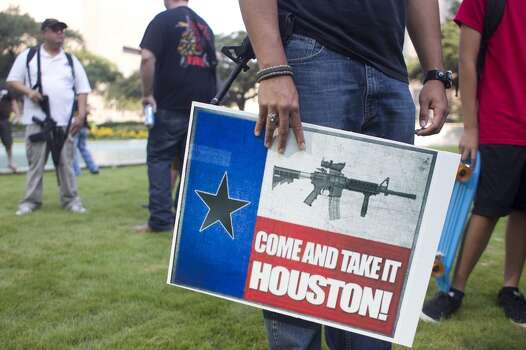 "WIth guns in hand, a group of more than 20 people with the pro-gun organization, Come and Take it Houston, assembled at City Hall before walking through downtown carrying their guns as part of a rally Thursday, July 4, 2013, in Houston.<br /><br /><br /> ""This is a Come and Take it Houston walk to help inform citizens about the gun laws here in Texas,"" co-organizer  Kenneth Lindbloom said. ""In Texas there are no restrictions on the open cary of long arms like rifles and shotguns. We want people to realize that in the hands of good people, guns are not dangerous and they don't kill people. When good people have guns it serves as a deterrent to stop crime.""( Johnny Hanson / Houston Chronicle ) Photo: Houston Chronicle"