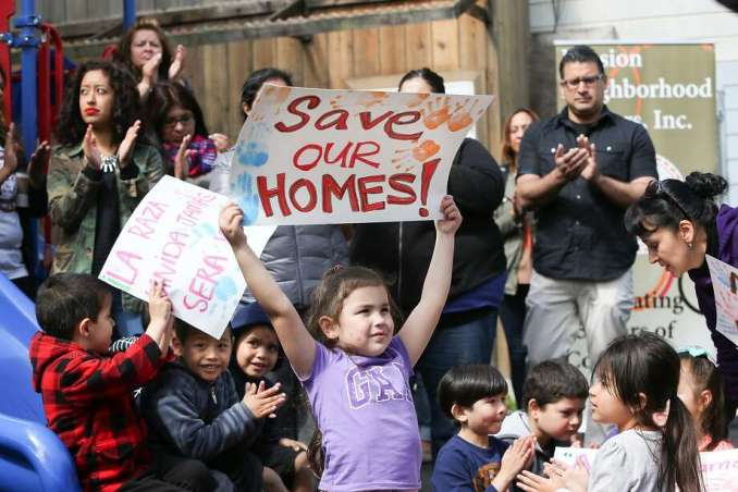 Children from the Mission Neighborhood Head Start Preschool hold signs during the press conference where Supervisor David Campos announced an ordinance calling for a temporary moratorium on construction of market-rate housing in the Mission on Tuesday, May 5, 2015 in San Francisco, Calif. Photo: Amy Osborne, The Chronicle