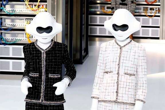 TOPSHOT - A picture taken on October 4, 2016 shows creations for Chanel during the 2017 Spring/Summer ready-to-wear collection fashion show in Paris. / AFP PHOTO / PATRICK KOVARIKPATRICK KOVARIK/AFP/Getty Images