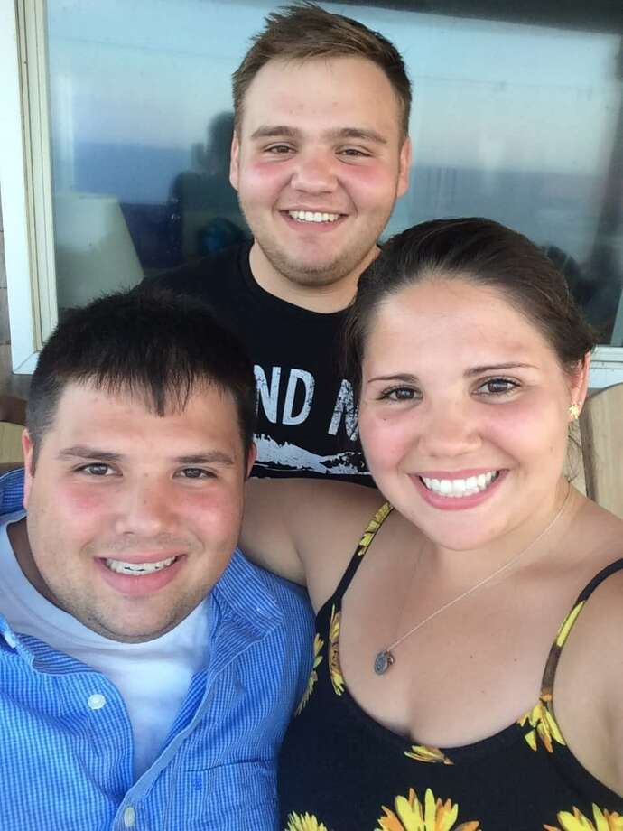 Jimmy Galante, of Latham, lower left, died of a heroin overdose at 26 on Dec. 27 after relapsing following intensive residential treatment and two years of being clean. His mother took this photo of him with his sister, Abby, and brother, Michael, during last summer's family vacation in North Carolina's Outer Banks. It was the happiest his mother had seen him in many years. (Photo courtesy of Marytheresa Galante)