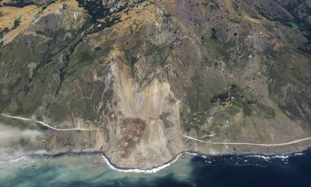 In this aerial photo taken Monday, May 22, 2017 provided by John Madonna showing a massive landslide along California's coastal Highway 1 that has buried the road under a 40-foot layer of rock and dirt. A swath of the hillside gave way in an area called Mud Creek on Saturday, May 20, covering about one-third of a mile, half a kilometer, of road and changing the Big Sur coastline. (John Madonna via AP) Photo: John Madonna, Associated Press