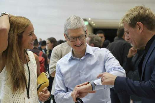 Apple CEO Tim Cook, center, in mid-September 2017 wearing an Apple Watch 3 at a product event in Cupertino, Calif. Under co-founders Dr. Shea Gregg and Dr. Kristin Gregg, Connecticut-based FallCall Solutions is developing a system for the Apple Watch to detect the severity of any fall by an elderly person and call for help. (Jim Wilson/The New York Times) Photo: JIM WILSON / NYT / NYTNS