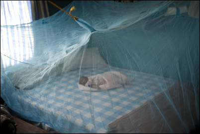 Infant in Nigeria sleeps beneath an insecticide-treated bednet that prevents the transmission of malaria, a disease that kills thousands of children in Africa annually.  Nothing But Nets press release