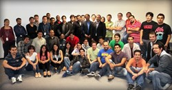 Anurag Kumar, CEO and Guillermo Ortega COO with part of iTexico's development team throughout Guadalajara