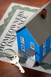 Homeowners Insurance form, toy house and key