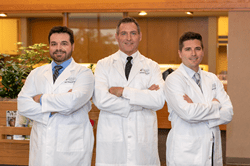 Drs. John Wewel, Jerome Wees, and Dr. Benjamin Anderson of Midwest Oral Surgery & Dental Implants in Omaha, NE