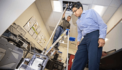 WPI professor Nikhil Karanjgaokar conducts an experiment to observe how waves move through granular materials immersed in liquid, which could be used for shock protection.