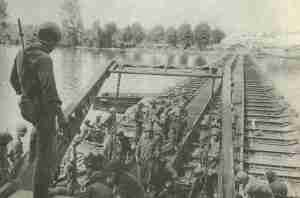 US engineers constructing a bridges across river Seine.