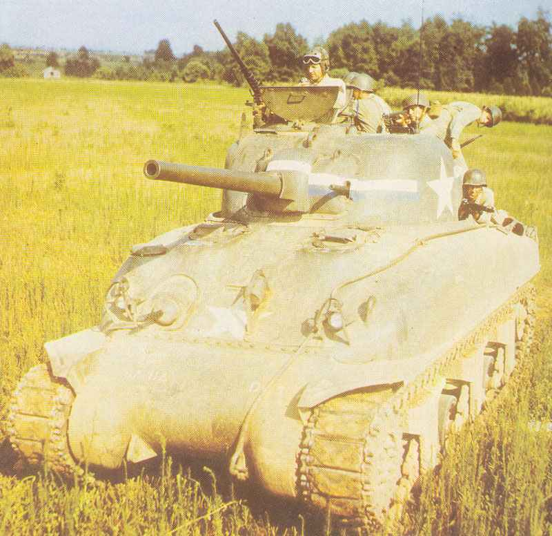 Sherman of the US Army with infantry fighting from the tank