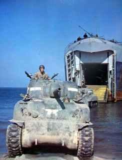 Shermans leaving a landing ship.