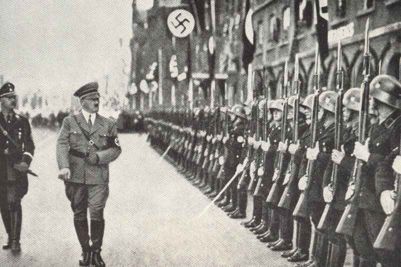 Himmler and Hitler walking in front of a SS honour guard company.