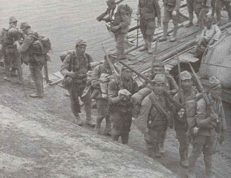 Japanese soldiers crossing a pontoon bridge in China