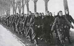German infantry company is marching behind the Siegfried Line