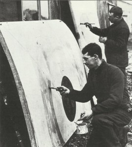 British ground staff is painting wing parts with the new markings