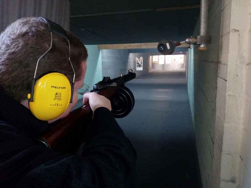 A cartridge is leaving the sub-machine gun.