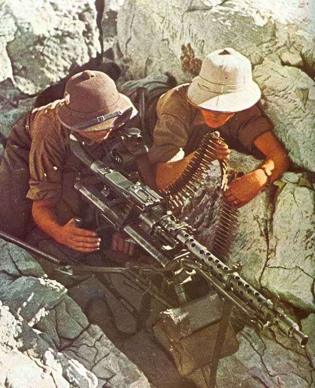 MG34 mounted on its tripod with long range sights for sustained fire role
