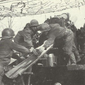 US artillery bombarding German positions