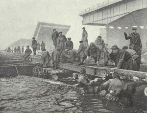 Russian pioneers build a pontoon bridge