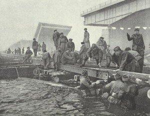 Russian pioneers build a pontoon bridge
