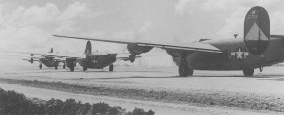 B-24 Liberators of the Far East Air Force command taxy out at the start of a mission.