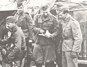 3 Dutch SS soldiers with two Latvians
