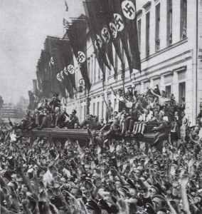 Crowds cheer Hitler