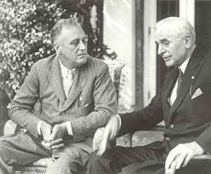 Roosevelt is talking with his foreign minister Cordell Hull.