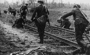 Partisans mining railway tracks