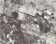 Ethiopian guerillias are shooting on an Italian fort.
