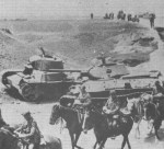 ussian OT-133 flame-tank lies abandoned next to a T-34 Model 1941