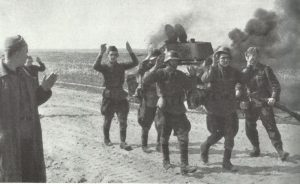crew of a knocked-out Russian T-34 tank surrenders
