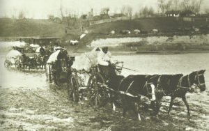 German supply column crosses a ford in Romania