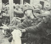 Russian PoWs beg for a piece of bread